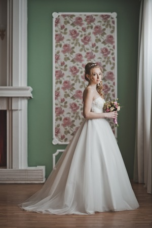 advertises: The model advertises a wedding dress. Stock Photo