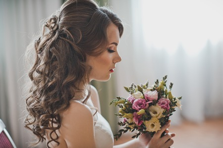 fullface: Full-face of the girl with a bouquet.