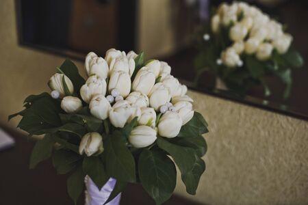 reflexion: Flowers with reflexion in a mirror.