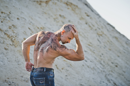 The brutal man with a tattoo. Stock Photo