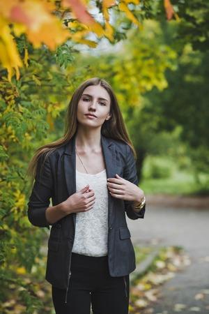 tetbury: Business girl on autumn walk.