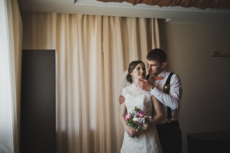 tenderly: Husband tenderly embraces his wife. Stock Photo