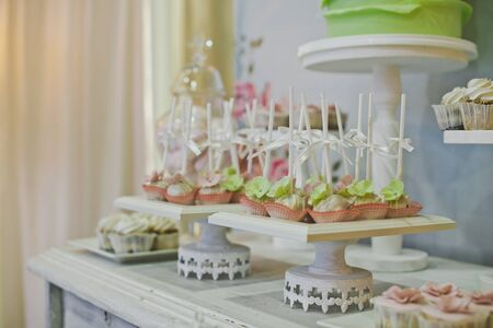 treats: Sweet treats on the table for guests. Stock Photo