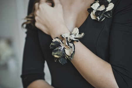 corsage: The corsage on the girls hand.