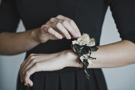 corsage: The girl with the buttonhole on his arm.