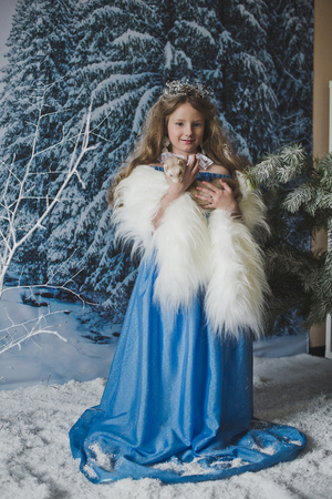 ferret: Snow Princess with the ferret in his hands.