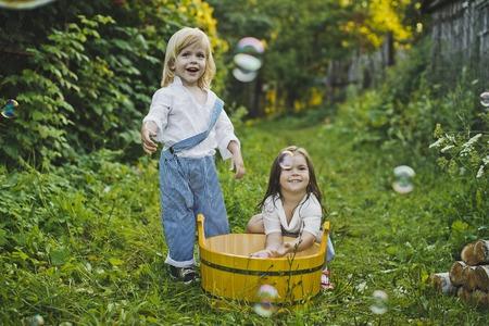children play: Children play with water in the garden.