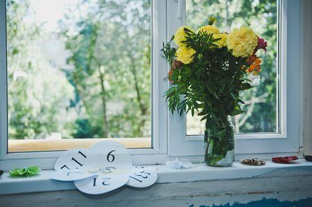 windowsill: Flowers on the windowsill.