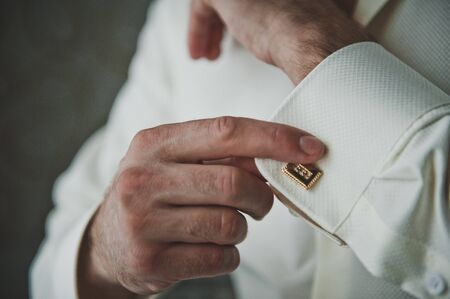 cuff link: The process of dressing businessman.