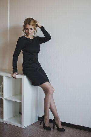 little black dress: A girl in a little black dress.