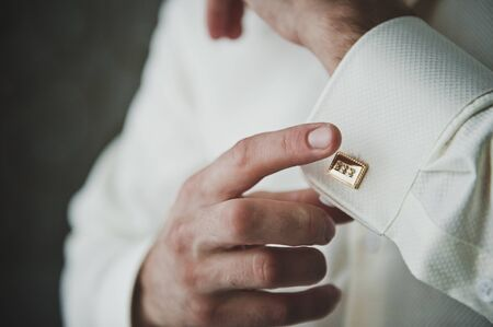cuff links: The process of dressing businessman.