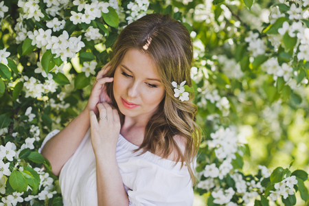 Close-up portrait of a girl in a white dress. Stock Photo