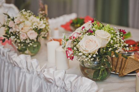 Festive tables decorated with cloth and flowers. Stock Photo