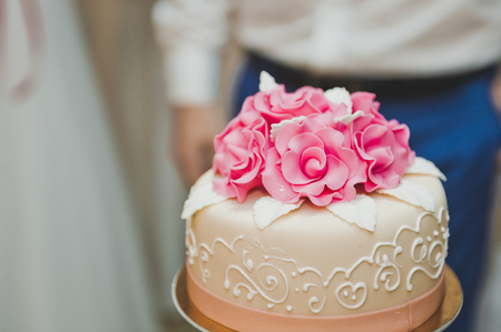 Wedding cake three tier with flowers.