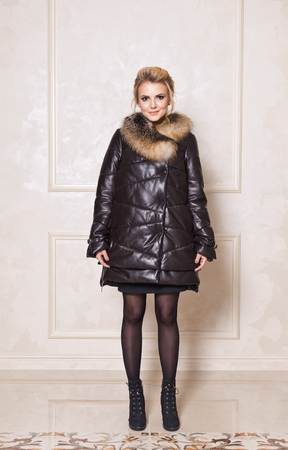 Girl in luxury fur coat made from natural materials. Stock Photo