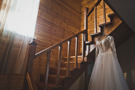 The brides dress lies on the staircase leading to the second floor.