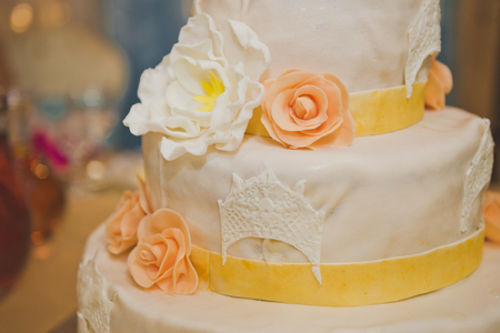 Cake in three tiers for the guests at the wedding.