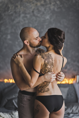 Man removes clothes from the girls. Stock Photo