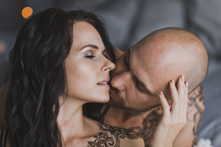 Passionate kiss and the stroking of her husband.