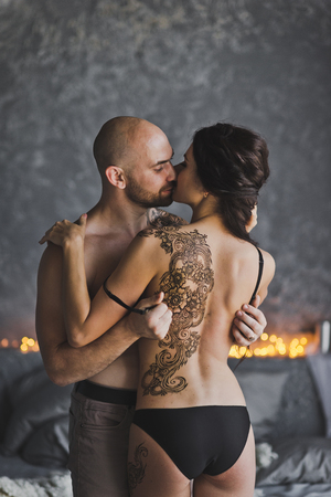 The process of exposure of a female back tattoo.