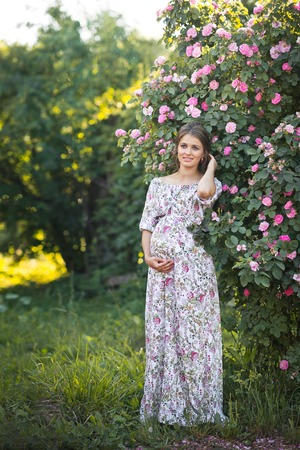 Photos of a pregnant girl for advertising or posters. Stockfoto