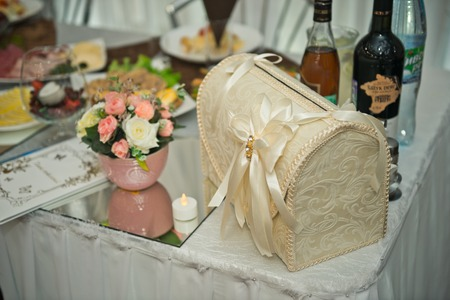 Beige treasure chest for gifts at the wedding.