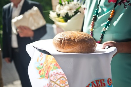 Russian custom to meet guests with bread and salt.
