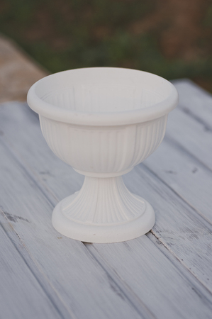 Beautiful white vase in the old style.