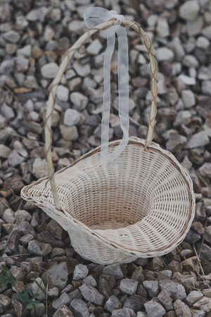 Openwork basket in the shape of a hat with a high handle.