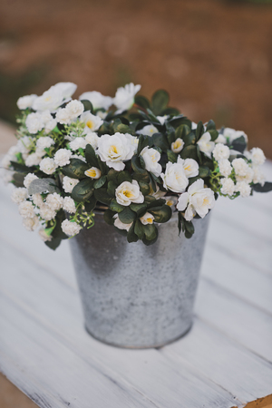 A bouquet of Jasmine in a small bucket.