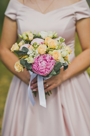 Beautiful bouquet in hand close-up. Imagens - 111988364