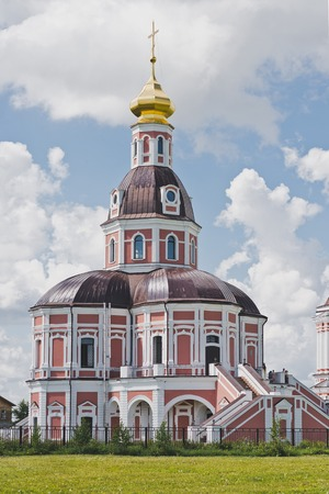 Beautiful ensemble of two-storey Church and bell tower. Фото со стока - 111988367