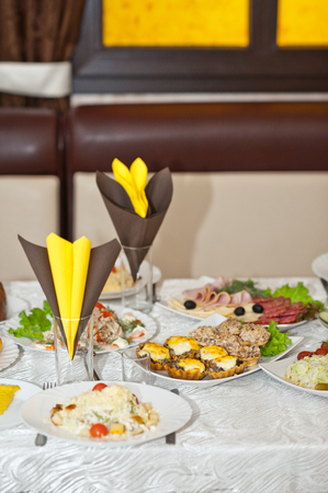 Decoration of the wedding table with various treats. Фото со стока - 111988422