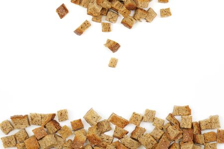 A scattering of crackers made from wheat bread