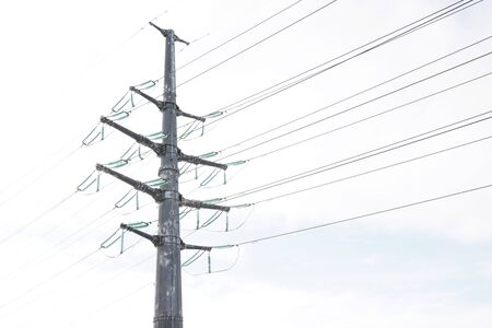 high voltage pole with voltage in an open field.