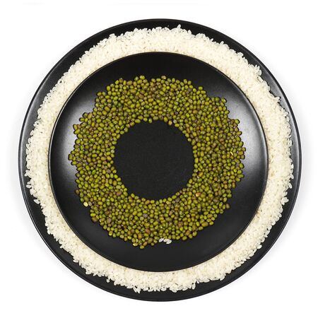 Mash. Mung bean on a plate, on a white background. View from above. Isolated photo. Bean concept