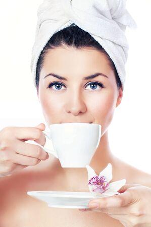 Beauty women drinking tea, isolated on white photo