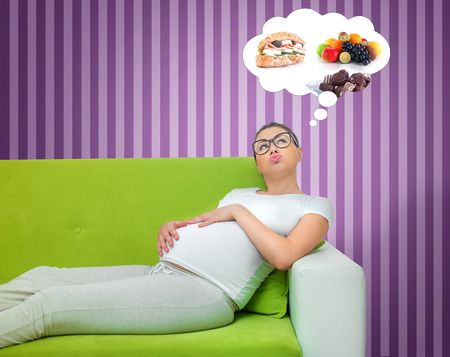 Pregnant woman thinking about food. Hungry expectant mother lying on the couch.Egoist concept. manipulation