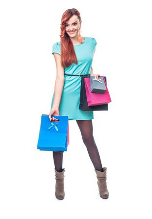ショッピング バッグ、白い背景で隔離の女性。全長 - 総図 写真素材