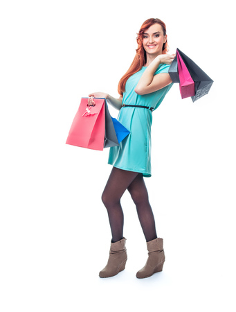 Woman with shopping bags, isolated on white background. Full length - total figure