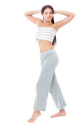 総: Pretty young woman doing exercise, full length. Isolated on white background