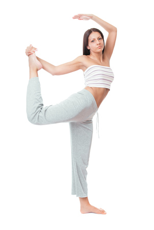 Pretty young woman doing exercise, full length. Isolated on white background