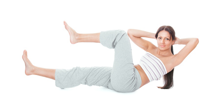 Attractive healthy young woman stretching gym, abdominal muscles isolated on white