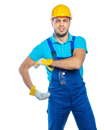 Builder in a protective blue clothing holding or wearing  something, very heavy isolated on white background.
