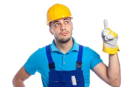 Thoughtfull builder pointing up to something, isolated on white background