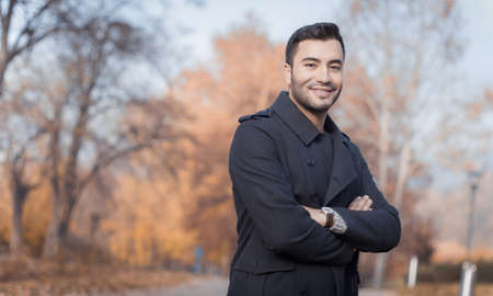 Young man, outdoors. Smile guy in a park, autumn day