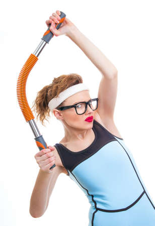 Funny woman with expander, fitness girl over white background