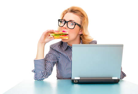 Funny hungry business woman eating sandwich on work, isolatd on white. Studio shot