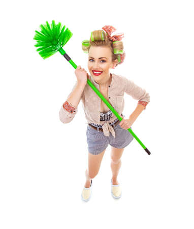 Funny cheerful smile housewife with broom, isolated on white background.