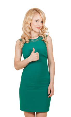 beautiful blonde in green dress holds a thumb up Banque d'images